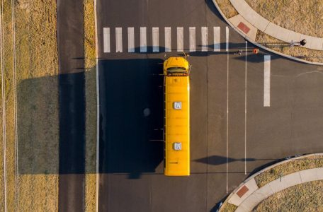 Aerial view of school bus driving on a rural street